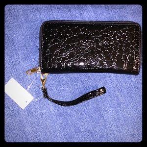 Black snakeskin patent leather wristlet
